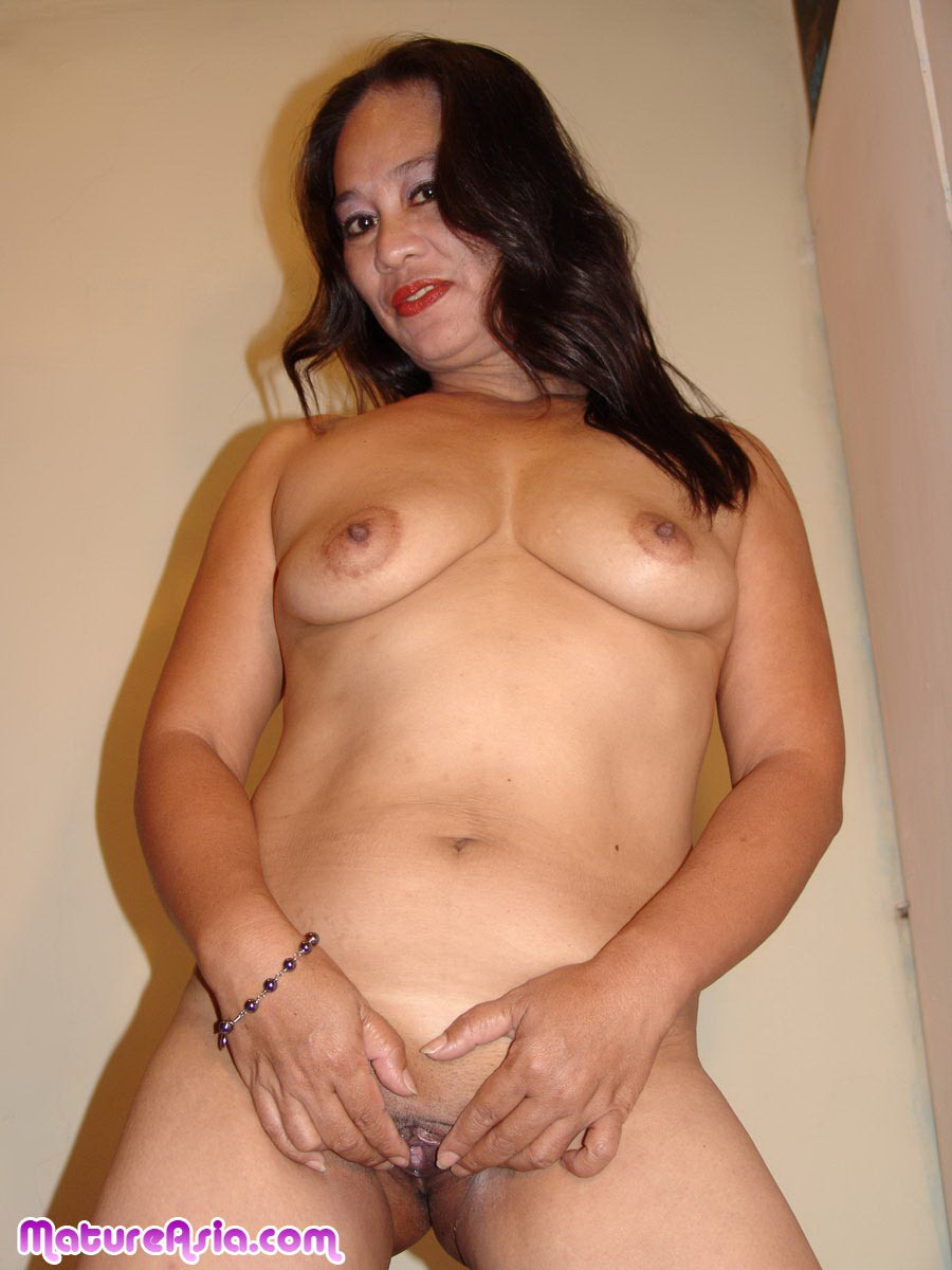 Excited mature asian woman posing