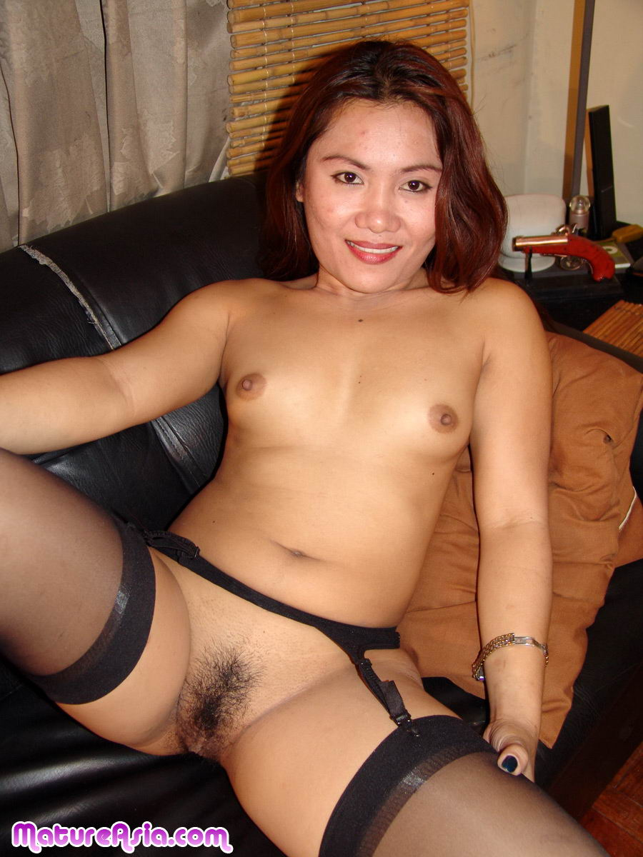 Chubby asian MILF in nylon stockings stripping and posing.